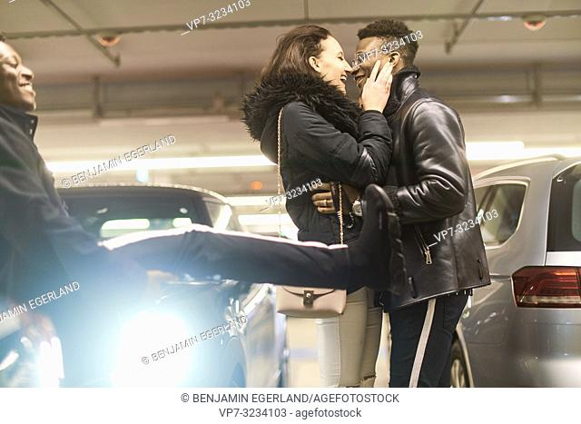 adventurous couple kissing in parking garage, adventure flirt dating, in Munich, Germany