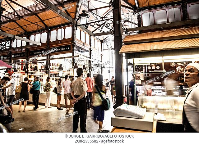 Mercado San Miguel market, City centre, old street and buildings of Madrid
