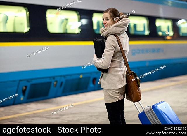 Young woman waiting for her connection in a modern train station