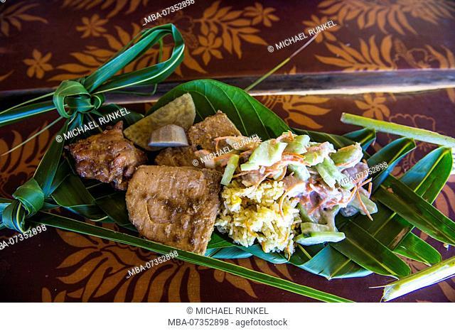 Local food served on a plam leave, Bora Bora, French Polynesia