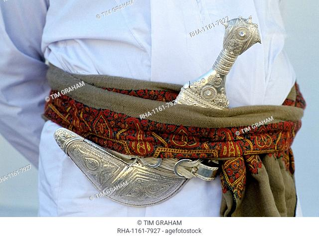 Omani man's khanjar dagger at cultural performance in Muscat in Oman, Middle East