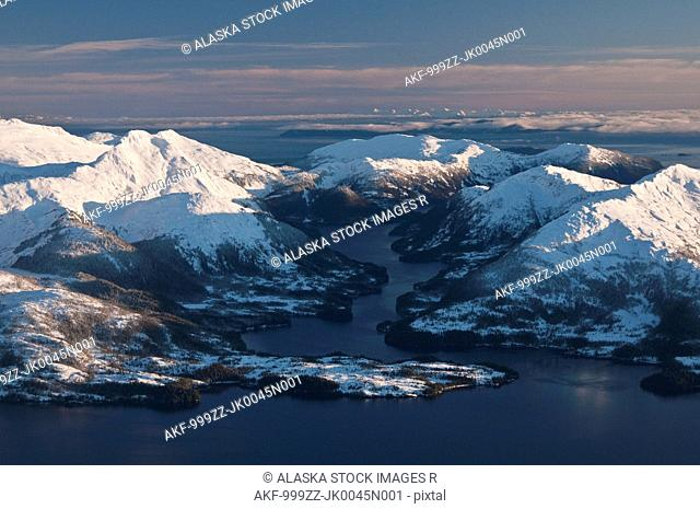 Scenic aerial view of an inlet in the Prince William Sound, Chugach National Forest, Chugach Mountains, Southcentral Alaska, Winter