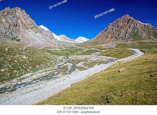 Mountain road along river. Tien Shan