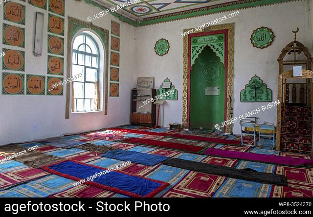 Inside of small Islamic mosque in a town in Kyrgyzstan