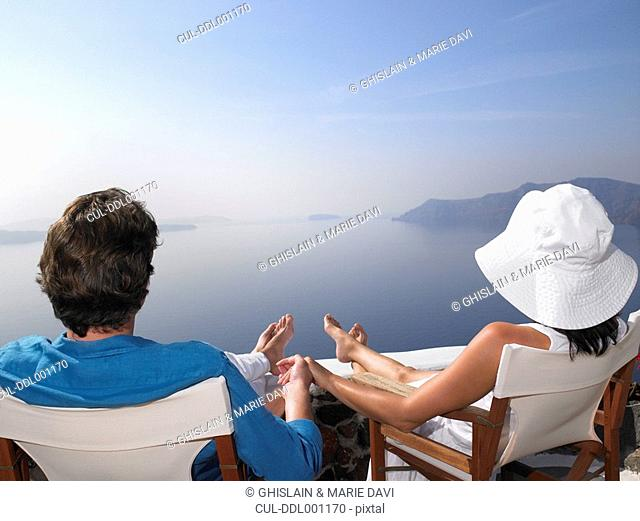 Couple sitting on a sundeck