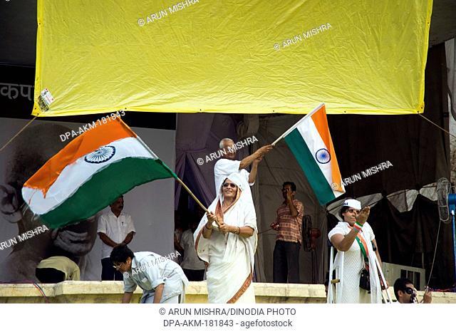 Anna Hazare with flag on the stage of ramlila maidan new delhi India Asia