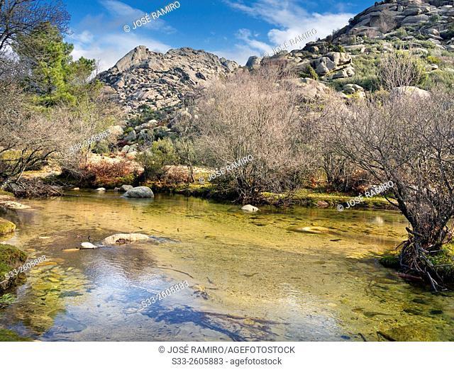 Sirio cliff and Manzanares river in the Pedriza. Sierra de Guadarrama. Manzanares el Real. Madrid. Spain. Europe