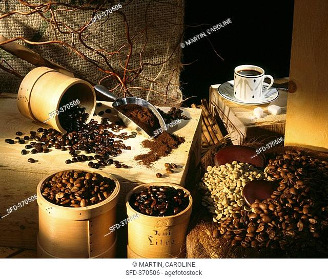 Coffee beans, ground coffee and a cup of coffee