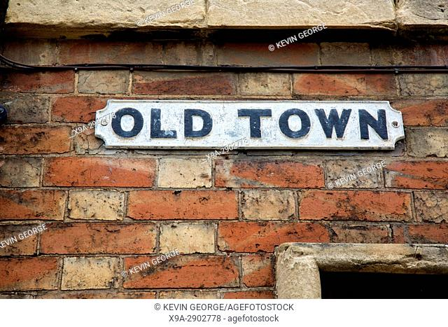Old Town Street Sign on Red Brick Wall