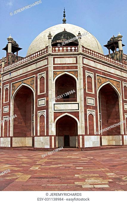 Humayun's Tomb. Islamic mausoleum. Large red sandstone building decorated with inlaid white marble in Delhi, India