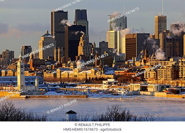 Canada, Quebec province, Montreal, Port, Old Montreal and downtown, from the shores of the St. Lawrence in the mist of strong morning frost in winter