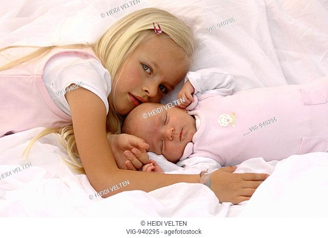 A little girl with her baby brother. - GERMANY, 01/07/2008