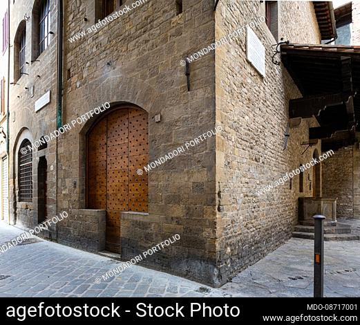 One of the various doors of the Dante Alighieri House Museum in the homonymous street. Florence (Italy), April 16th, 2021