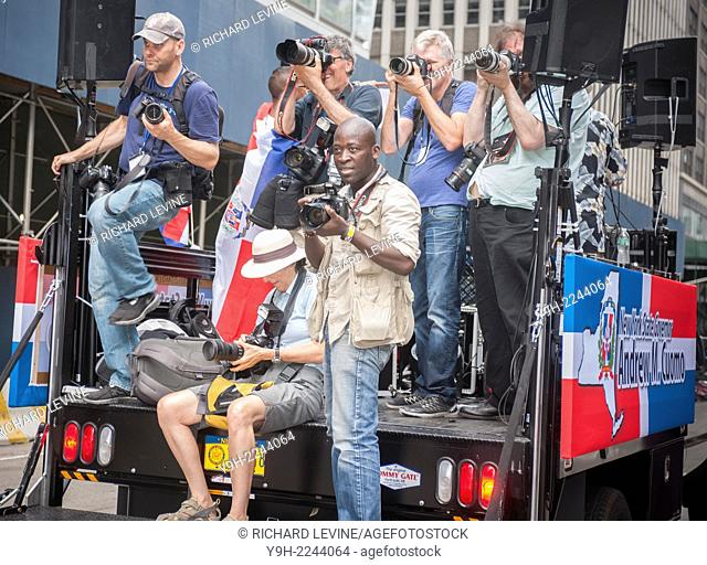 Photographers on a flatbed truck provided by New York State Governor Andrew Cuomo during the 32nd Annual Dominican Day Parade in New York