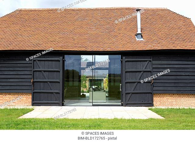 Glass sliding doors of converted barn home