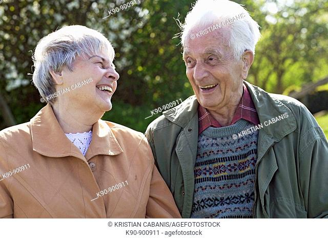 Elderly caucasian couple looking and laughing at each other, Island of Amrum, Northfrisian, Schleswig-Holstein, Northern Germany, Europe