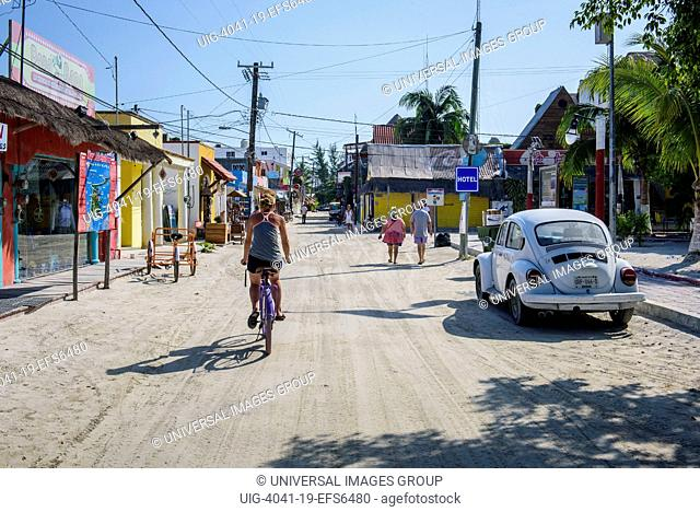 Tourists in a street of Isla Holbox, Quintana Roo, Mexico