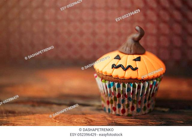 Halloween design homemade cupcake on dark background