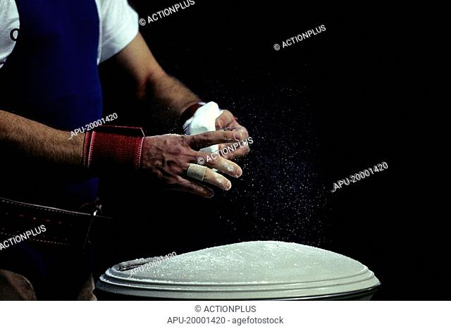 Weightlifter chalking his hands