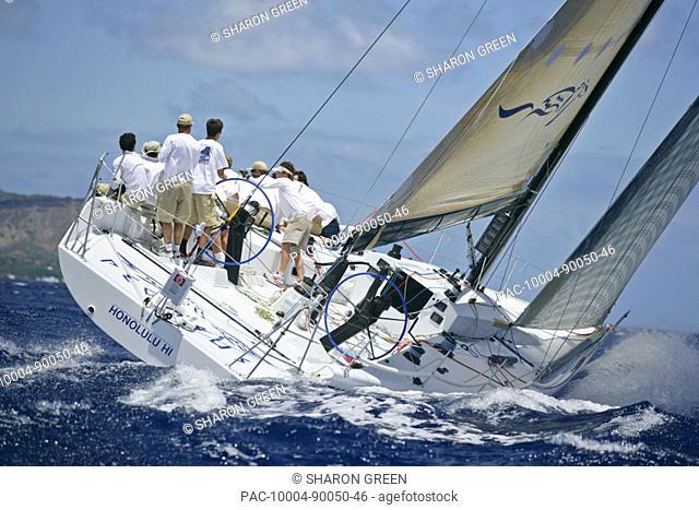 Hawaii, Oahu, Waikiki Offshore Series 2005, sailboat on blue ocean, land in background
