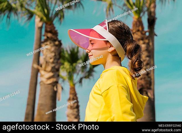 Little girl wearing sun visor in summer