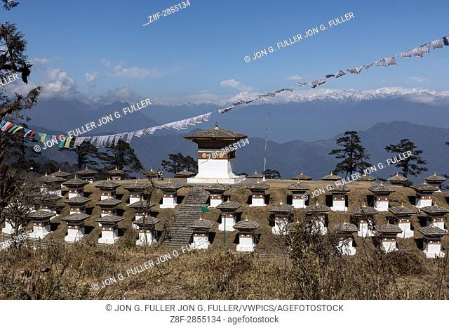 The 108 Druk Wangyal Khang Zhang Chortens, or stupas, are a sacred Bhuddist memorial. They are red-band or khangzang chortens and are located on a hilltop at...
