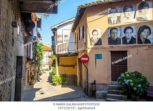 Street and portraits of neighbours on facades. Mogarraz, Sierra de Francia Nature Reserve, Salamanca province, Castilla Leon, Spain