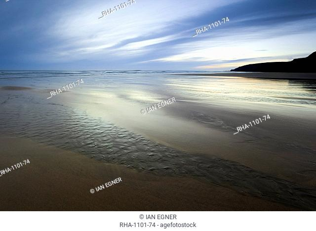 Beach streams leading to the sea on Sandymouth Bay, Cornwall, England, United Kingdom, Europe