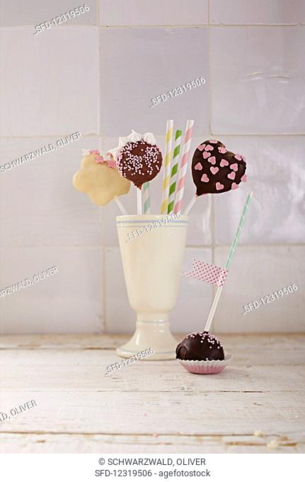 Different cake pops served in a ceramic cup