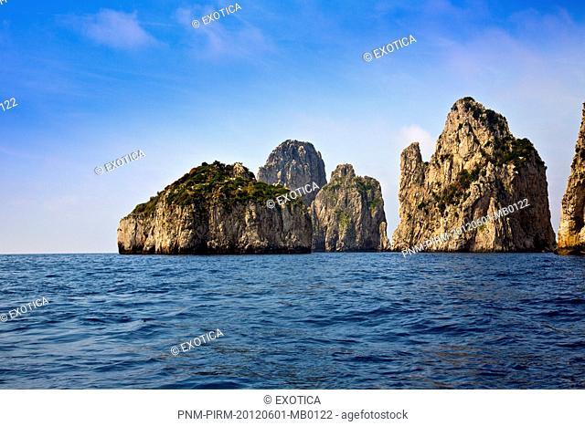 Limestone cliffs and cave in the sea, Capri, Campania, Italy