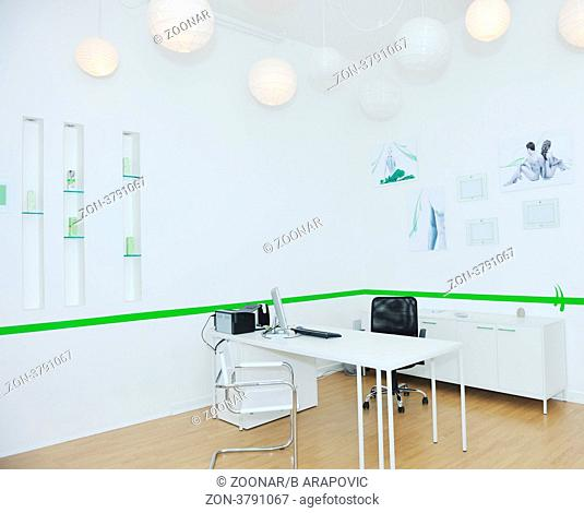 bright and modern office indoor with table and computer