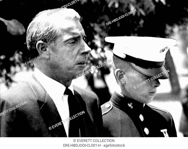 JOE DiMAGGIO-DiMaggio and son, Joe DiMaggio, Jr., walking behind the hearse carrying Marilyn Monroe's casket, 8/8/62 - CPL Archives/Everett Collection