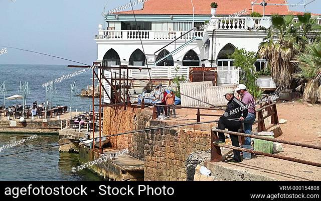 A group of lebanese man fishing in Ain El Mraiseh. Beirut. Lebanon