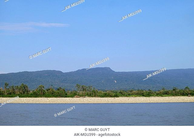 Shingle river bank along the Alto Madre de Dios River, Lower Amazon rainforest in Madre de Dios department in Peru. With low forested hill in the background