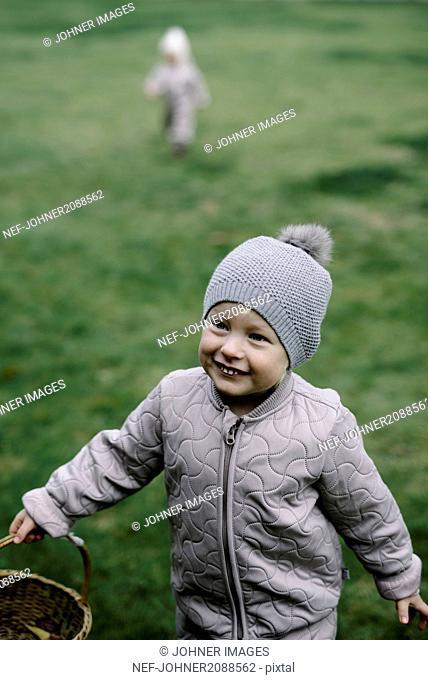 Girl having fun on swing in playground