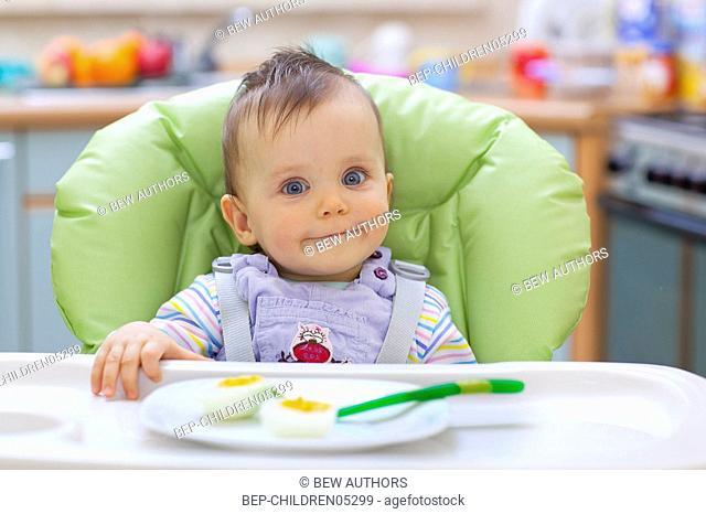 Little girl having a meal