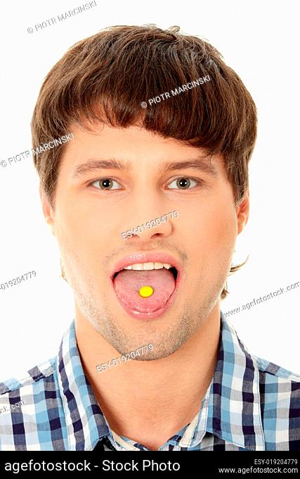Young handsome man taking a pill