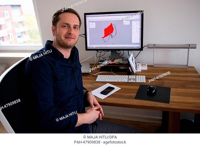 Designer Markus Krauss sits in front of his computer in Hamburg, Germany, 11 April 2014. Krauss has designed a rocking chair that can rock but also stand still
