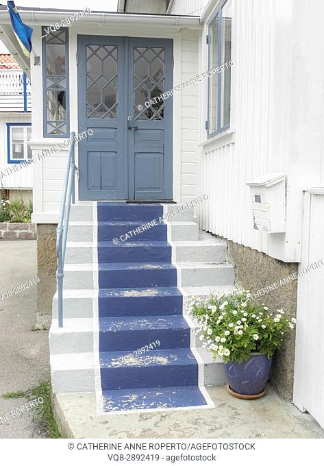 Blue painted stair carpet on traditional wooden house in coastal conservation area near Gothenburg, Sweden