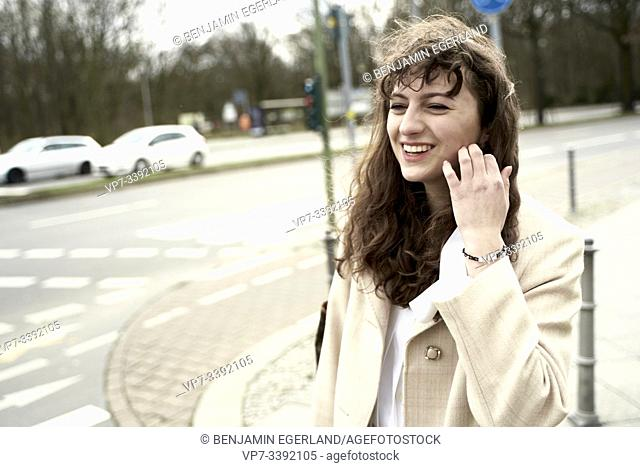 young woman walking on the street, Berlin, Germany