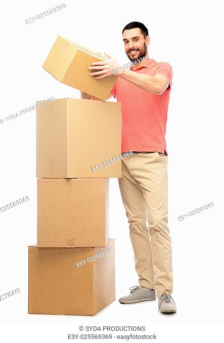 delivery, moving, people and logistics concept - happy man with cardboard boxes