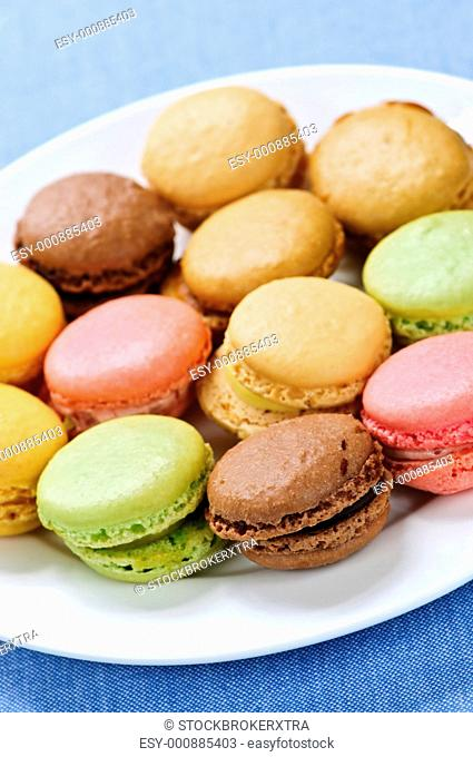 Fresh multicolored macaroon cookies served on a plate