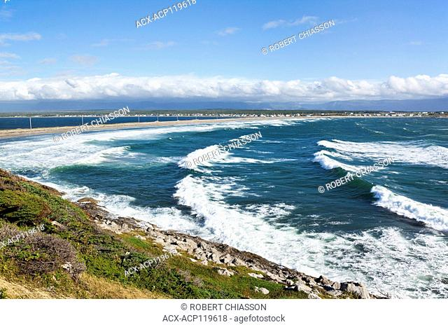 Shallow Bay in Cow Head is characterized by near-constant wave action abuting a 2,5 km isthmus that links the town (in the background) to the Cow Head Peninsula...