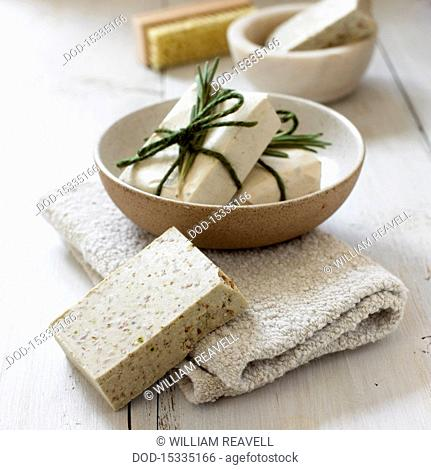 Rosemary soap in a bowl and on towel, close-up