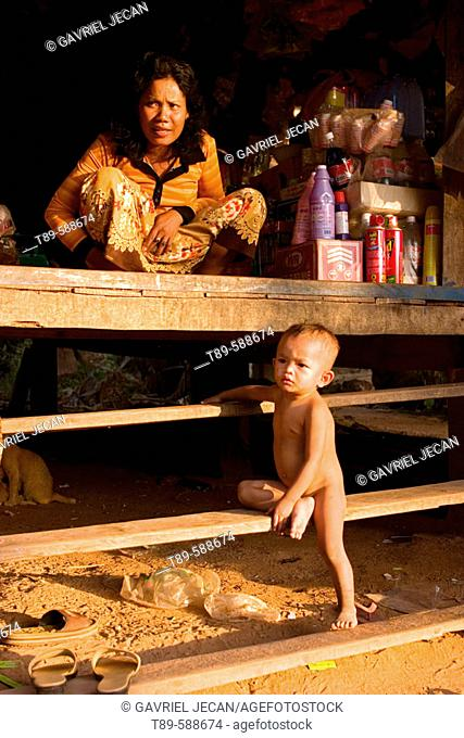 Mother and Mother and Child in a  Portable homes on water, Asia, Cambodia, Lake Tonle Sap
