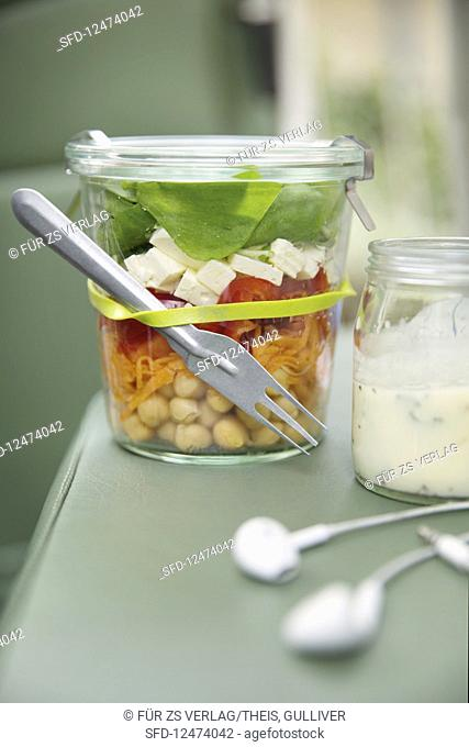 Rainbow salad with feta cheese in a jar