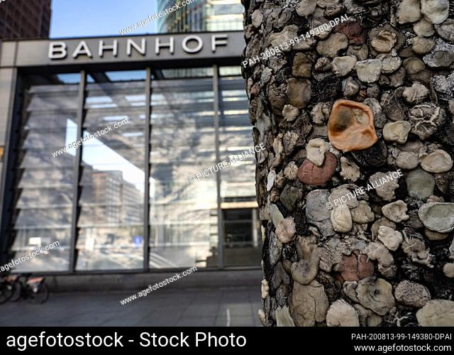 13 August 2020, Berlin: A piece of the wall covered with chewing gum stands at Potsdamer Platz. Today 59 years ago, on August 13, 1961