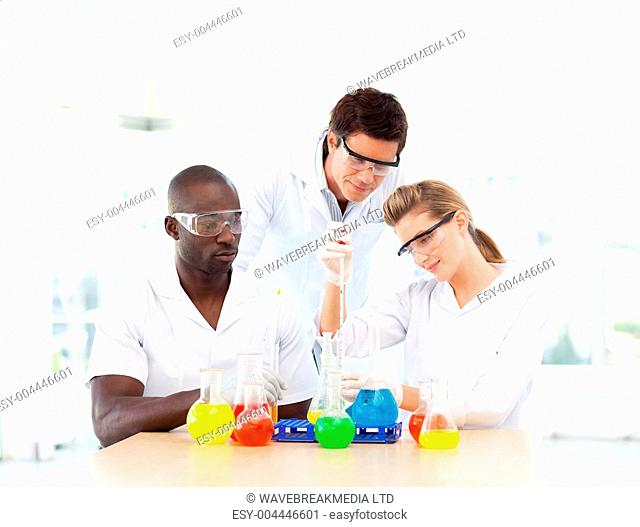 Scientists examining test-tubes
