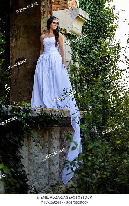 Young bride in abandoned house