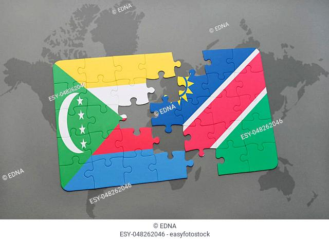 puzzle with the national flag of comoros and namibia on a world map background. 3D illustration
